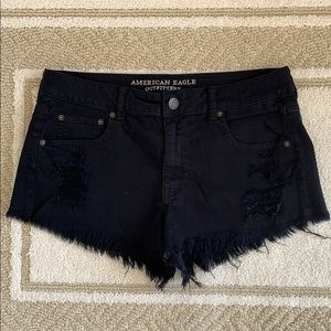 Distressed black shorts